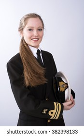 Portrait of a young female naval officer with long brown hair