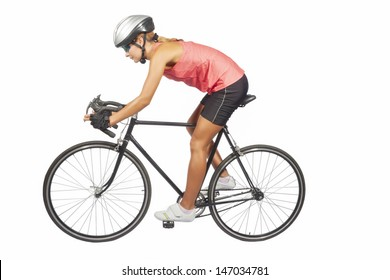 portrait of young female professional cycling athlete posing with racing bike.model equipped with professional sport gear, isolated over pure white background. horizontal shot