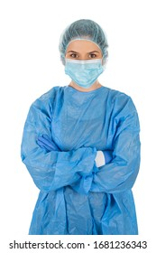 Portrait of a young female surgeon wearing protective uniform, mask, cap and gloves on isolated background