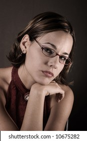 Portrait of young female wearing reading glasses