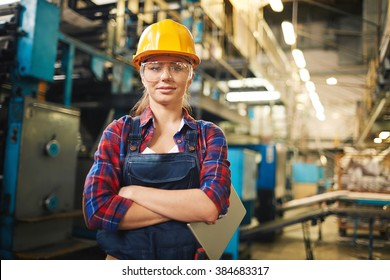 Portrait of young female worker in the factory