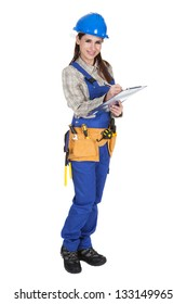Portrait Of Young Female Worker Writing On Clipboard
