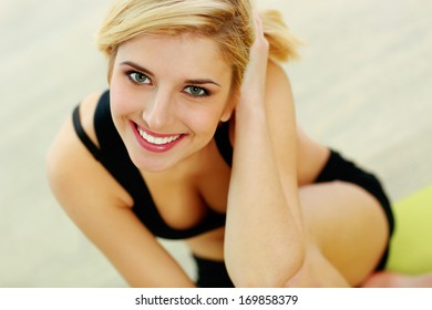 Portrait of a young fit woman smiling on camera