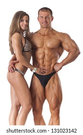 Portrait of young fitness couple on white background