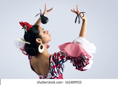 Portrait of young Flamenco dancer in beautiful dress