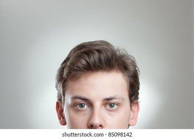 portrait of a young man´s forehead and eyes with empty space