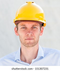 Portrait of a young foreman with hard hat