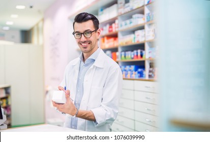 Portrait of a young friendly male pharmacist.