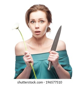 portrait of young funny caucasian brunette  woman with flower and knife isolated on white