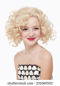 Portrait of a Young Girl with Blond Wig Posing as Marylin Monroe
