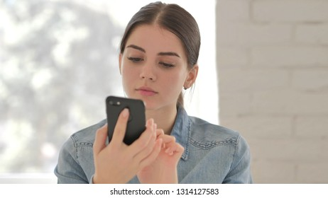 Portrait of Young Girl Busy Using Smartphone