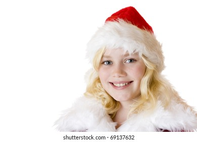 Portrait of young girl with christmas cap. . Isolated on white background.