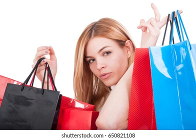Portrait of young girl with colored bags after shopping isolated on white background