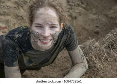 Portrait of young girl in dirty clothes
