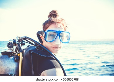 Portrait of a young girl diver on a sunny day.