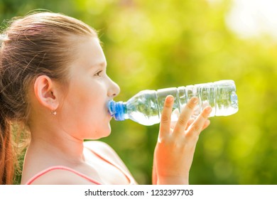 Portrait of a young girl drinking a bottle of water