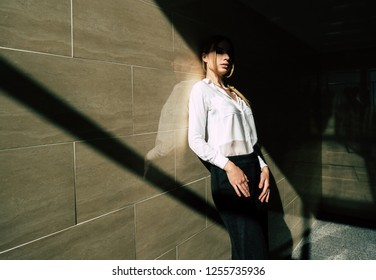 Portrait of a young girl of European appearance. Photo with the play of light and shadow