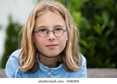 portrait of a young girl with eyeglasses