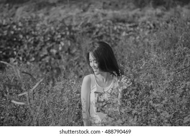 Portrait of young girl in the forest at sunset