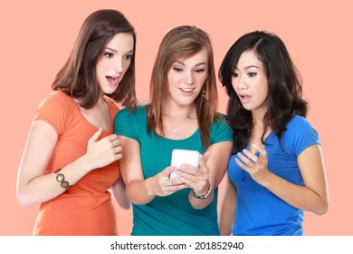 portrait of young girl friend shock looking at mobile phone