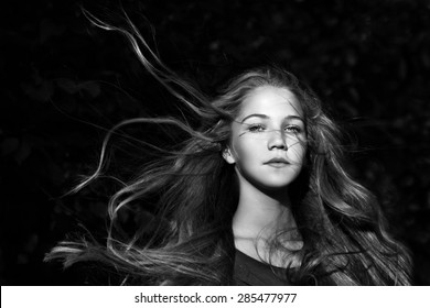 portrait of young girl with long hair