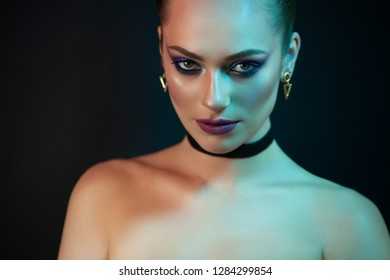 Portrait of a young girl of model appearance, which shows a bright, daring and confident image.