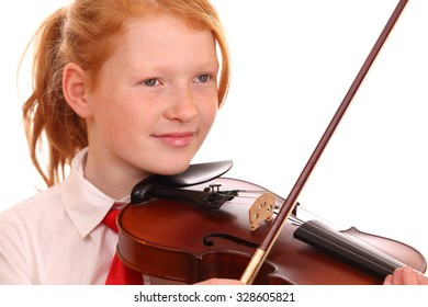 Portrait of a young girl playing violin on white background