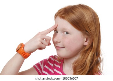 Portrait of a young girl pointing with finger at forehead on white background