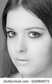 Portrait of a young girl with professional makeup close-up black and white image