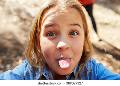 Portrait Of Young Girl Pulling Face For Selfie Photograph