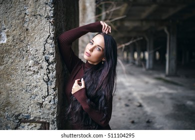 portrait of a young girl in pullover urban style