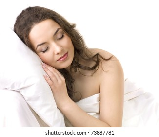 Portrait of a young girl sleeping on a pillow