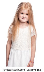 Portrait of a young girl smiling and embarressed. Studio shot on white background.