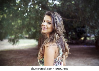 Portrait of a young girl smiling with nature background
