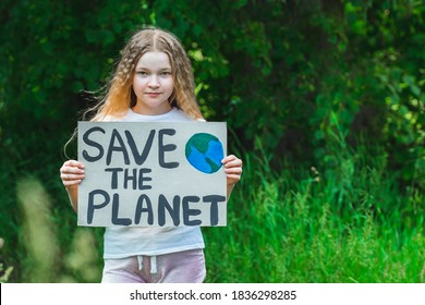 portrait of young girl standing with Save the planet Poster on school backyard. piles of plastic garbage on ground. teen kid child volunteer protest against earth pollution, global warming, recycle.