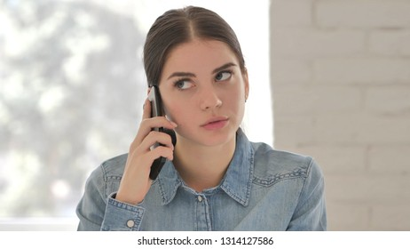 Portrait of Young Girl Talking on Phone