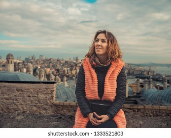 Portrait of the young girl with the view of old Istanbul behind her