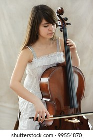 Portrait of young girl with violoncello