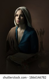 Portrait of a young girl who looks into the camera. Renaissance. A woman in a retro dress. Historical reconstruction.