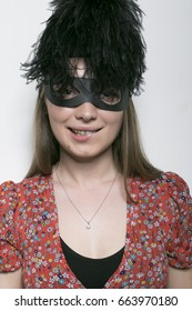 Portrait of a young girl in a zorro mask, a smile and a playful look, facial expressions