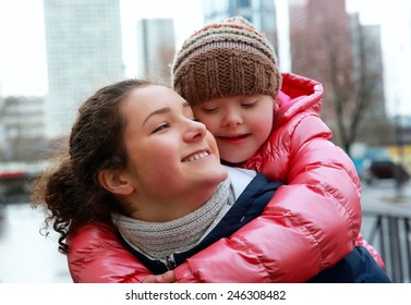 Portrait of young girls together in the city