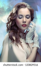 Portrait of young glamourous woman on sparkling background in old Hollywood style