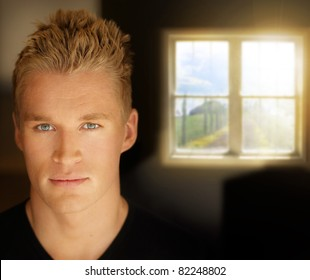Portrait of a young good looking man with window in background