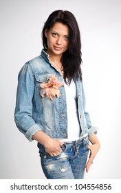 Portrait of a young gorgeous woman in denim