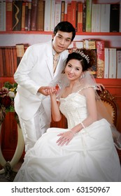 Portrait of young groom and bride in elegant dress