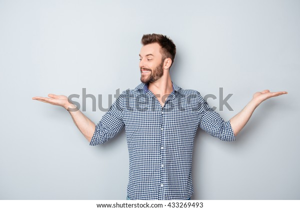 Portrait of young guy choosing between two different options
