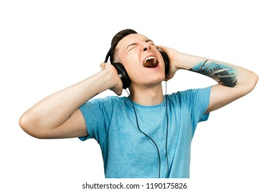 Portrait of young guy listen music in a headphones isolated on a white background.