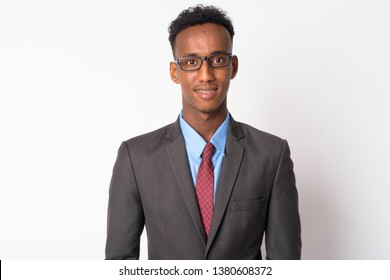 Portrait of young handsome African businessman with eyeglasses smiling