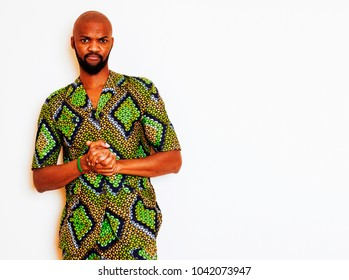 portrait of young handsome african man wearing bright green nati
