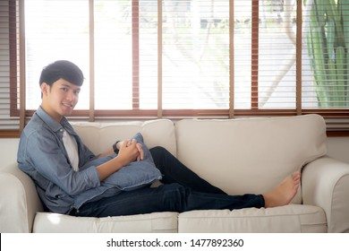 Portrait young handsome asian man napping relax with cozy on sofa at home, asia male resting and sleeping in weekend with tired and lazy on couch in vacation, lifestyle and wellbeing concept.